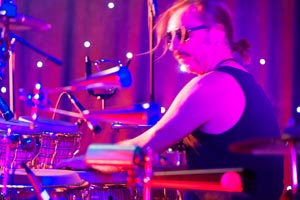 Percussionist Colin Lovatt with Santana tribute band, spins a drumstick