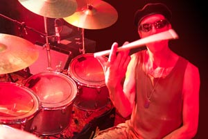 Steve Wyse drummer with Santana tribute band, spins a drumstick